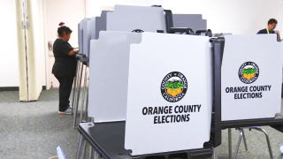 A woman votes in Orange County