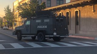 An armored SWAT vehicle responds to a shooting.