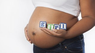 pregnant african american black woman its a girl shutterstock_207947656