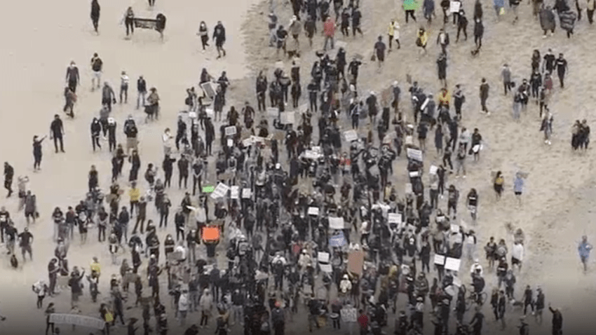 Protesters march at Venice Beach .