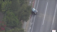 Pursuit Ends With Driver Reversing Into Curb