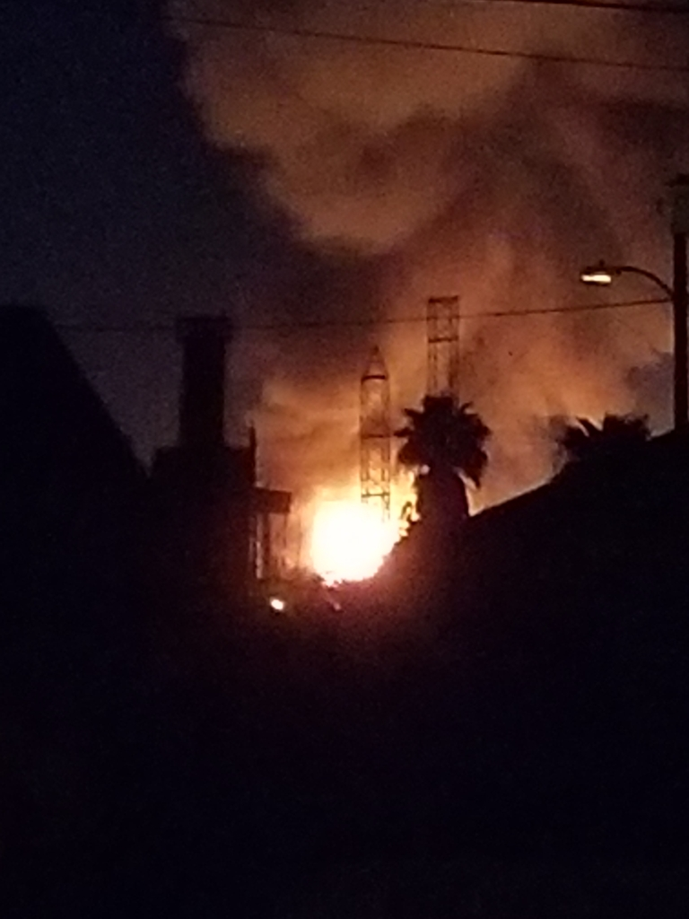A fire burns at a Carson oil refinery.