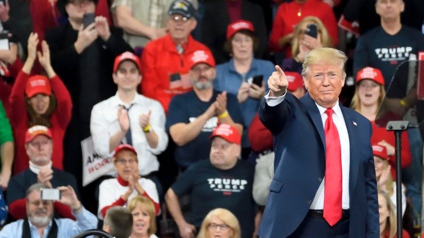 In this Dec. 10, 2019, file photo, U.S. President Donald Trump greets supporters as he steps on the stage for a campaign rally with Vice President Mike Pence at the Giant Center in Hershey, PA.