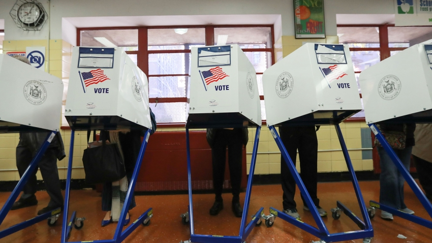 In this file poto, voters cast their ballots in 2016 in New York, United States.