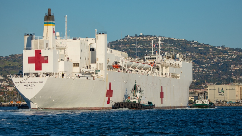 In this March 27, 2020, file photo, tugboats guide the USNS Mercy hospital ship to moor at the Port of Los Angeles in Los Angeles, California, U.S.