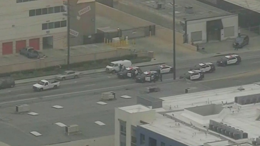 Officers pursue a pickup.