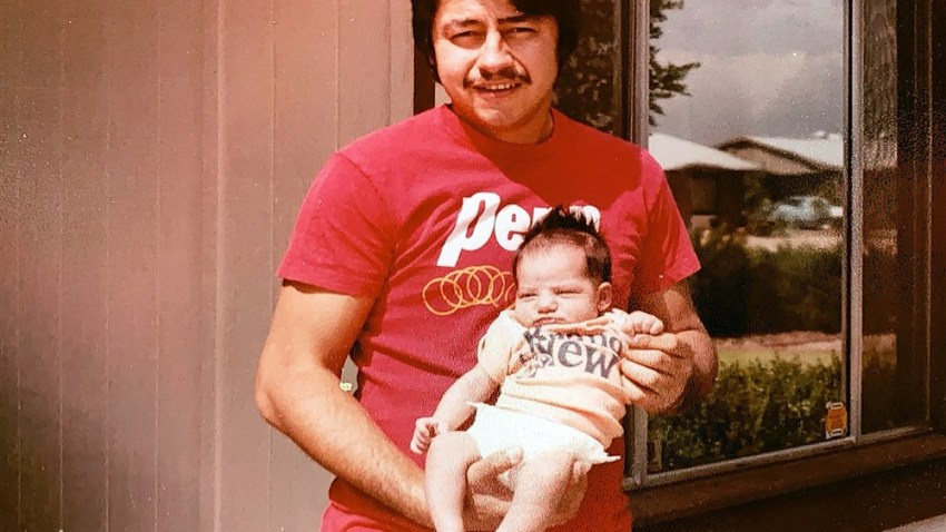 """The family of Mark Anthony Urquiza, seen here holding his daughter Kristin as a newborn, touched a nerve when they blasted elected officials for their """"carelessness"""" in response to the coronavirus pandemic. Urquiza died of COVID-19 in Arizona."""