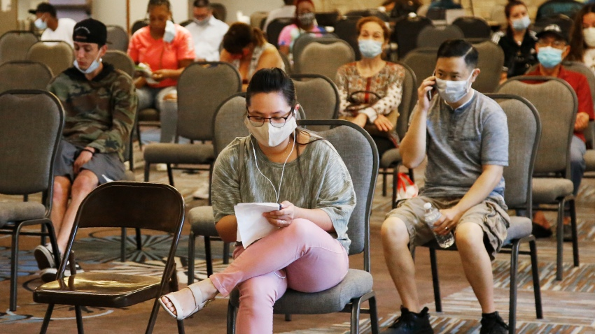 People wait to speak with representatives from the Oklahoma Employment Security Commission about unemployment claims Thursday, July 9, 2020, in Midwest City, Okla.