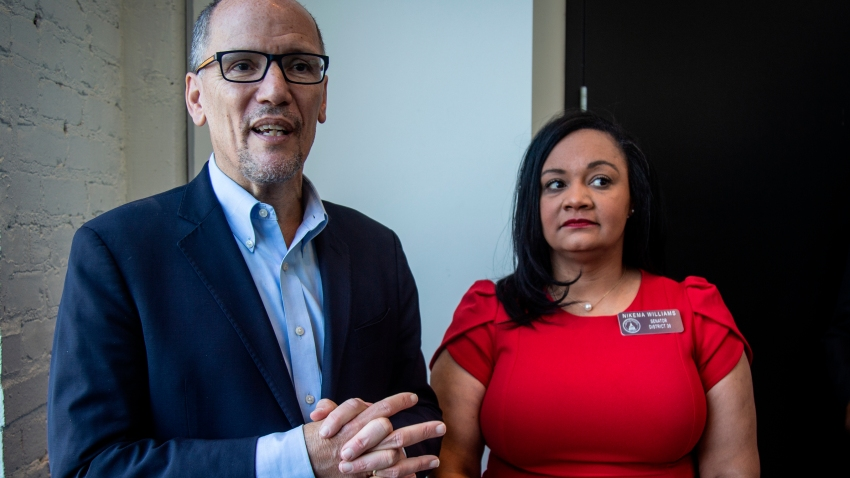 FILE-In this Wednesday, Nov. 20, 2019 file photo, Tom Perez, left, chair of the Democratic National Committee, and Nikema Williams, chair of the Georgia Democratic Party, speak with reporters, in Atlanta. Georgia Democrats have selected state Sen. Nikema Williams, chair of the state party, to replace Rep. John Lewis on the ballot in November.
