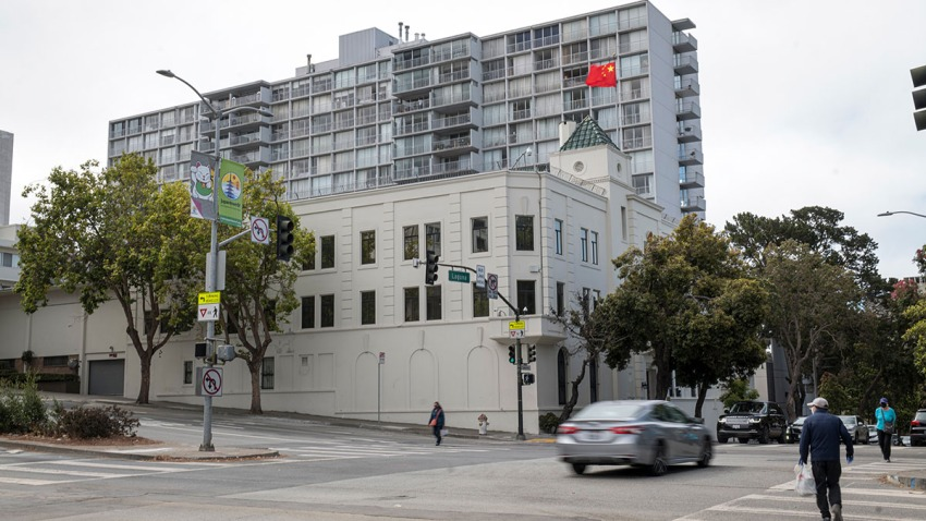 Pedestrians walk past the China Consulate General building in San Francisco, Calif., July 23, 2020.