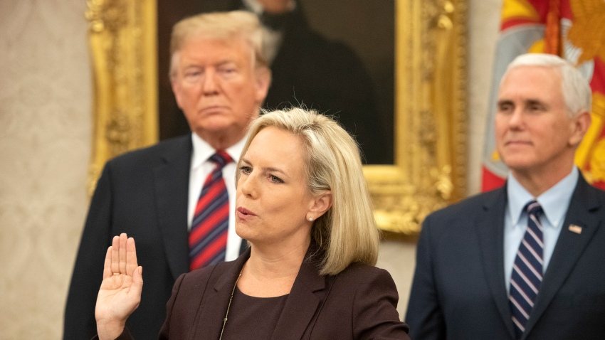 WASHINGTON, DC - JANUARY 19: United States Secretary of Homeland Security (DHS) Kirstjen Nielsen, center, administers the oath of citizenship to five people as U.S. President Donald Trump, left, and Vice President Mike Pence, right look on during a naturalization ceremony in the Oval Office of the White House in Washington, DC on Saturday, January 19, 2019.