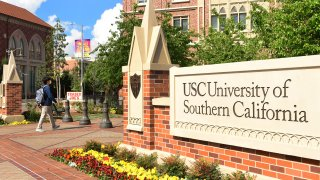 A student wears a facemask at the University of Southern California (USC) in Los Angeles, California on March 11, 2020, where a number of southern California universities, including USC, have suspended in-person classes due to coronavirus concerns.