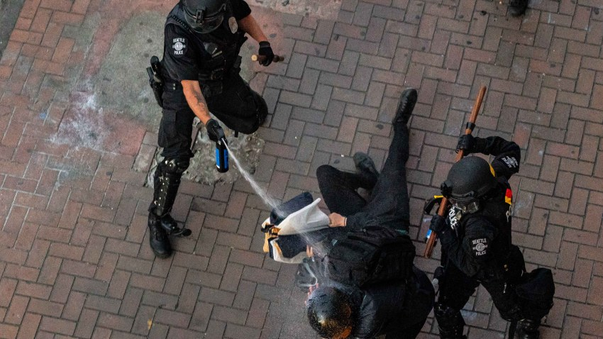 Police disperse demonstrators with pepper spray during protests in Seattle on July 25, 2020 in Seattle, Washington. Police and demonstrators clash as protests continue in the city following reports that federal agents may have been sent to the city.