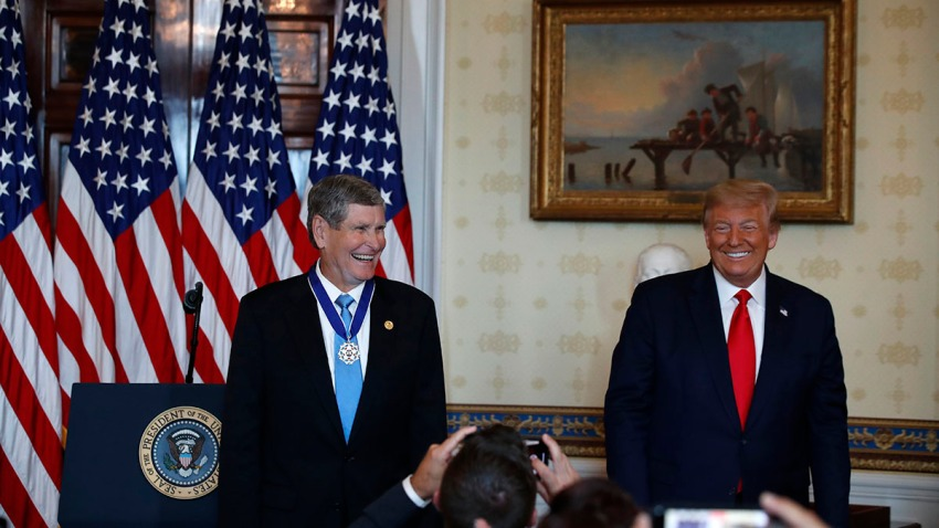 Olympian and former U.S. Rep. Jim Ryun stands with President Donald Trump, who presented him with the Presidential Medal of Freedom, in the Blue Room of the White House, July 24, 2020, in Washington.