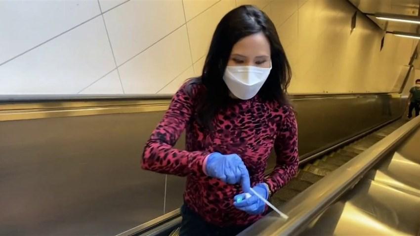 NBC News' Vicky Nguyen swabs an escalator.