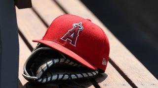 A baseball glove and Angels cap.
