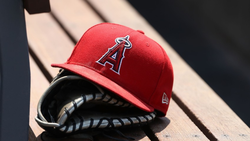 A baseball glove and Angels cap.