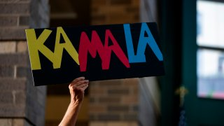 A rally attendee holds a campaign sign during a rally held by 2020 Democratic Presidential hopeful Senator Kamala Harris (D-CA) in Davenport, Iowa on August 12, 2019s.