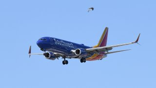 A Southwest Airlines jet comes in for a landing at McCarran International Airport on May 25, 2020 in Las Vegas, Nevada.