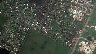 satellite imagery of a destroyed neighborhood near Lake Charles Memorial Hospital