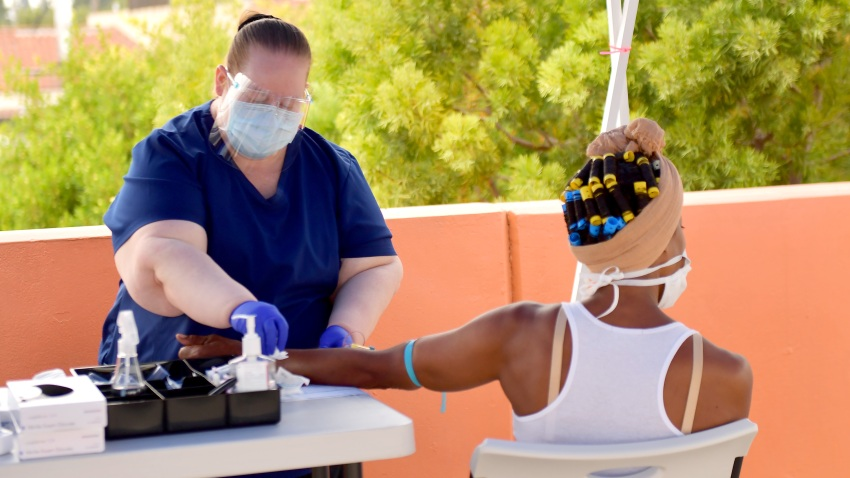 A medical worker administers an antibody test.