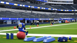 A Rams player in an empty stadium.