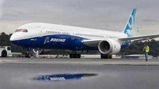 A Boeing 787-9 Dreamliner taxis after concluding its first flight September 17, 2013 at Boeing Field in Seattle, Washington. The 787-9 is twenty feet longer than the original 787-8, can carry more passengers and more fuel.