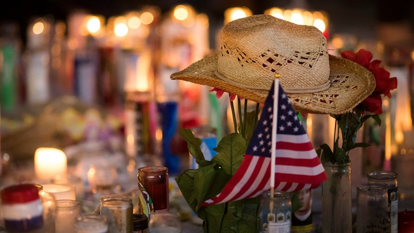 A hat is left at a makeshift memorial during a vigil to mark one week since the mass shooting at the Route 91 Harvest country music festival.