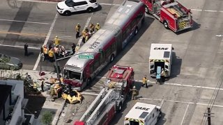 A bus and car collided in East LA.