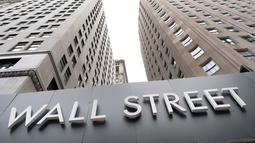 Buildings line Wall Street, Monday, Aug. 31, 2020, in New York.
