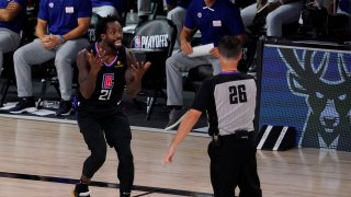 Los Angeles Clippers' Patrick Beverley (21) reacts to a call by referee Pat Fraher (26) during the second half of an NBA conference semifinal playoff basketball game against the Denver Nuggets Saturday, Sept. 5, 2020, in Lake Buena Vista, Fla.
