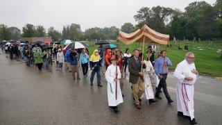 Churchgoers participate in a procession