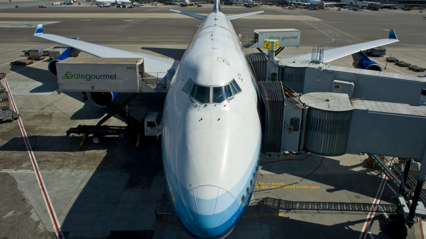 In this May 27, 2012, file photo, a Boeing 747-400 ready for departure to Hong Kong is parked at an SFO gate in San Francisco, California.