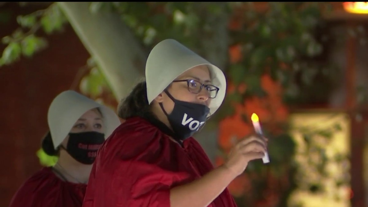 Many Dressed in 'Handmaid's Tale' Robes During Vigil For Judge Ruth Bader Ginsburg