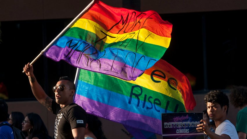 Ignacio Rios, left, of Santa Ana marches with fellow protesters against the detention of transgender women in Santa Ana on Thursday, May 4, 2017.