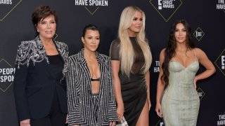SANTA MONICA, CALIFORNIA - NOVEMBER 10: (L-R) Kris Jenner, Kourtney Kardashian, Khloé Kardashian and Kim Kardashian attend`Kim Kardashian the 2019 E! People's Choice Awards at Barker Hangar on November 10, 2019 in Santa Monica, California.