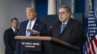 "Attorney General William Barr, right, speaks as U.S. President Donald Trump listens during a Coronavirus Task Force news conference in the briefing room of the White House in Washington, D.C., U.S., on Monday, March 23, 2020. Trump said the U.S. economy cant remain slowed for too long to fight coronavirus, declaring the country ""was not built to be shut down."""