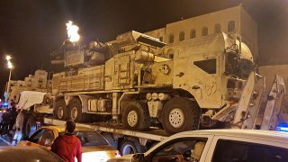 Forces loyal to Libya's UN-recognised Government of National Accord (GNA) parade a Russian-made Pantsir air defense system truck in the capital Tripoli on May 20, 2020, after its capture at al-Watiya airbase (Okba Ibn Nafa airbase) from forces loyal to Libya's eastern-based strongman Khalifa Haftar. - Libya's UN-recognised government scored another battlefield victory on May 18 against strongman Khalifa Haftar, capturing the key rear base used by his fighters in a conflict now in its second year. Haftar, who controls swathes of eastern Libya, launched an offensive in April last year against the capital Tripoli, seat of the UN-recognised Government of National Accord (GNA).