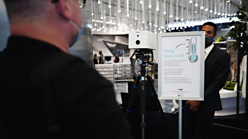 A visitors temperature is taken with an Iris Thermal Scanning device at the entrance to Edge observation deck at Hudson Yards as the city continues Phase 4 of re-opening following restrictions imposed to slow the spread of coronavirus on September 4, 2020 in New York City.