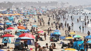 People gather on the beach at the Pacific Ocean on the first day of the Labor Day weekend amid a heat wave on September 5, 2020 in Santa Monica, California.