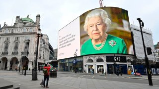 A still image of Britain's Queen Elizabeth II with a message of hope from her special address to the nation is seen on the giant billboard in Piccadilly Square, central London, April 18, 2020.