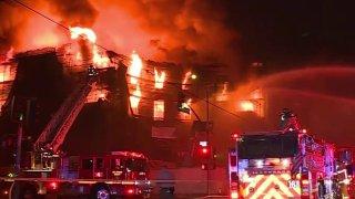 Fire burns an apartment building under construction.