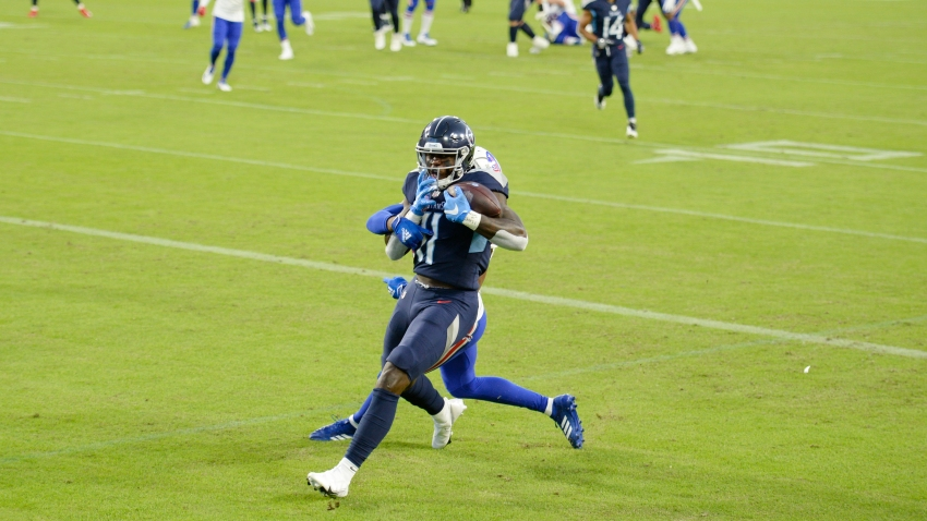 Tennessee Titans wide receiver A.J. Brown (11) catches a touchdown pass against the Buffalo Bills in the first half of an NFL football game Tuesday, Oct. 13, 2020, in Nashville, Tenn.