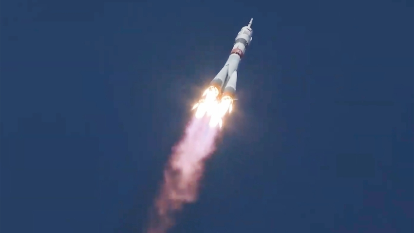 In this image made from video footage released by Roscosmos Space Agency, the Soyuz-2.1a rocket booster with the Soyuz MS-17 space ship carrying a new crew to the International Space Station (ISS), blasts off at the Russian leased Baikonur cosmodrome, Kazakhstan, Wednesday, Oct. 14, 2020. A trio of space travelers has launched successfully to the International Spce Station, for the first time using a fast-track maneuver to reach the orbiting outpost in just three hours.