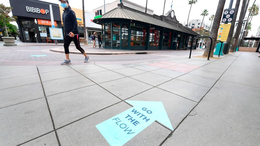 Arrows on the ground point in the direction shoppers are requested to walk abiding by social distancing guidelines.