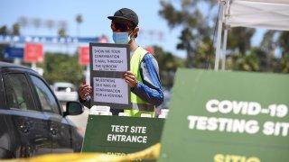 Staff direct drivers at a coronavirus testing site.