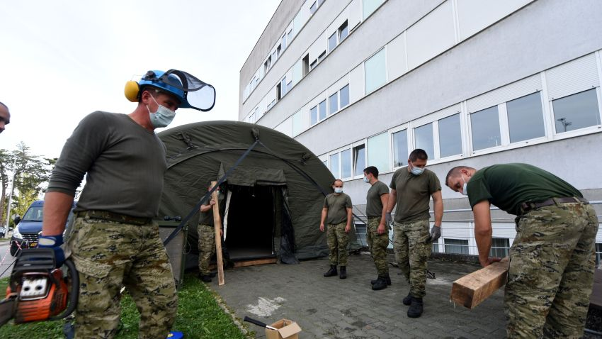 Soldiers of the Croatian Army set up tents in front of the Clinical Hospital Center Zagreb, the largest hospital in Zagreb, on October 9, 2020. After a sudden outbreak of coronavirus infection was recorded in Croatia in the last two days, the authorities decided to set up tents in which triage would be performed in the event of an increased number of people in need of hospital treatment.