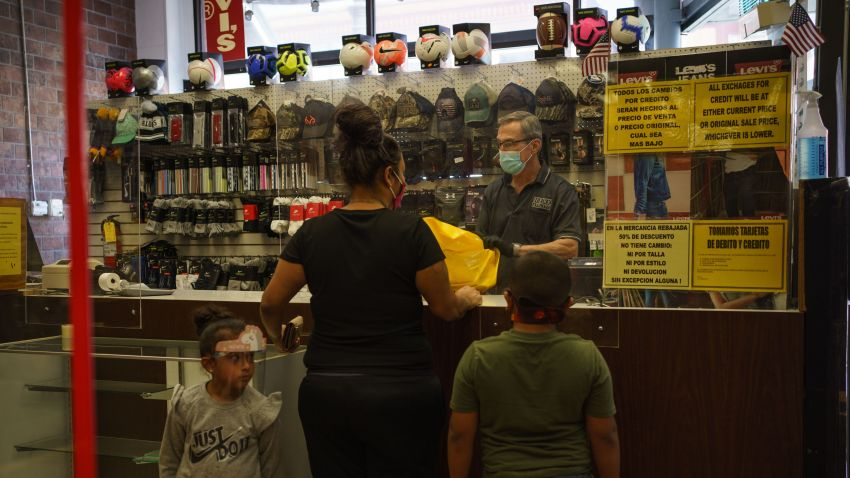 Gil Kimmelman, owner of Continental Dry Goods, checks out customers buying clothes on October 24, 2020 in El Paso, Texas.