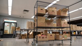 Boxes of grocers are on a large cart