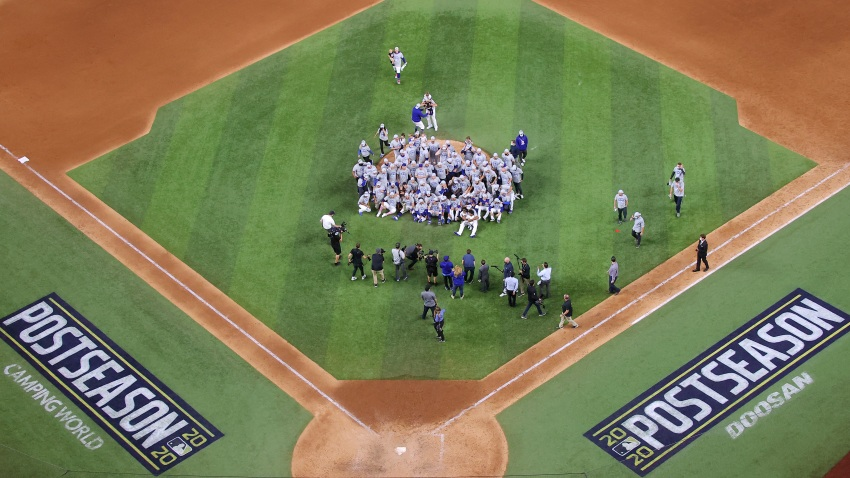 The Los Angeles Dodgers pose for a photo.